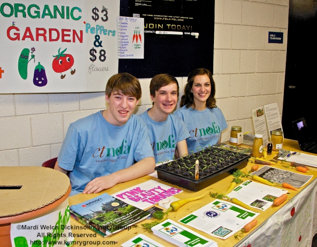 l. to r. Ben Foodman, WHS Sophmore; Adam Toris, WHS Senior; Stephanie Hubli, WHS Senior; WHS Organic Garden table. CTNOFA Winter Confdrence 2013, Wilton High School, Wilton, CT. ©Mardi Welch Dickinson/KymryGroup™All Rights Reserved.