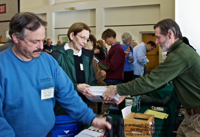 Participants buying books and merchandise from Jim Zipp, Owner, The Fat Robin. COA 29th Annual Meeting, Middlesex Community College. ©Mardi Welch Dickinson/KymryGroup™. All Rights Reserved.