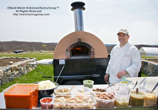 Quint Smith, Executive Chef, Stamford Yacht Club serving lunch on a firedupkitchens mobil  wood-fired oven at Hilltop Hanover Farm. Chef Farm Tour & Luncheon, Slow Food Metro North on April 15, 2013. ©Mardi Welch Dickinson/KymryGroup™ All Rights Reserved.