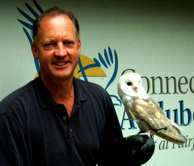 Alexander R. Brash, Connecticut Audubon Society's new president, holding a Barn Owl used for CAS education programs.  ©Connecticut Audubon Society
