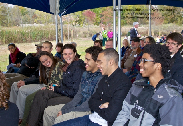 Students of The Common Ground High School listen & laugh as they hear fellow student and friend Michael Bruno speak at the Audubon Connecticut  Urban Oases program celebration. Barnard Nature Center, West River Memorial Park, New Haven, CT. October 30. 2013. ©Mardi Welch Dickinson/KymryGroup.All Rights Reserved.