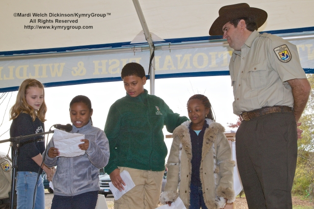 Students from The Barnard Environmental Studies Magnet School  reads a letter of thanks and talks about the importance of what this Urban Oases means to them. ©Mardi Welch Dickinson/KymryGroup. All Rights Reserved. National Wildlife Refuge Partnership, West River Memorial Park, New Haven, CT on October 30, 2013.
