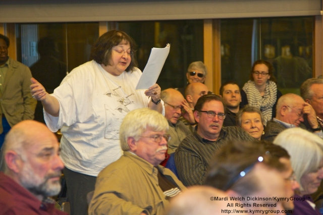 "Audience member reads a poem she wrote about the Passsenger Pigeon Joel Greenberg, author talk on ""A Feathered River across the Sky. The Passenger Pigeon's Flight To Extinction"" at Yale School of Forestry & Environmental Studies. New Haven, CT. March 12, 2014. ©Mardi Welch Dickinson/KymryGroup. All Rights Reserved."