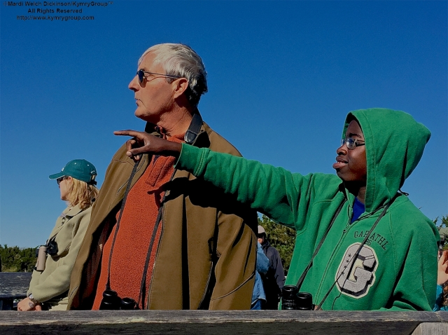 L. To R. Pete Dunne; Kojo Baidoo, Points out a Hawk to Pete Dunne while birdwatching at the Famous Cape May Point Hawk Watch Platform, Cape May Point State Park, NJ. ©Mardi Welch Dickinson. All Rights Reserved.