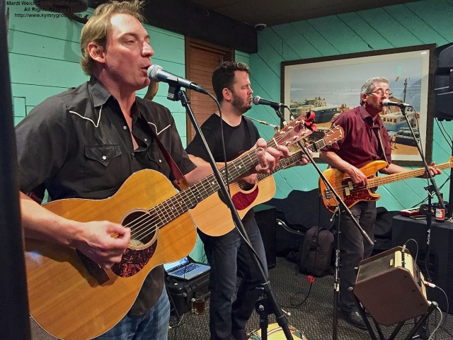 L.toR. Rudy Dauth, Wylie Shipman, Peter Riley of The Woedoggies, performing at the Rusty Nail for CMBO's Cape May Fall Birding Festival Kickoff Party, Cape May NJ. ©Mardi Welch Dickinson. All Rights Reserved.