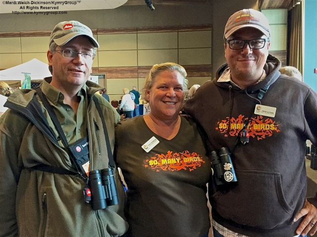 L. to R. Jeff Bouton, Marketing Manager, Leica Sport Optics USA & CMFF Exhibitor; Lillian Armstrong, Special Events Coordinator, CMBO; David La Puma, CMBO Director. Cape May Fall Birding Festival Trade Show Convention Hall, Cape May, NJ. ©Mardi Welch Dickinson All Rights Reserved.