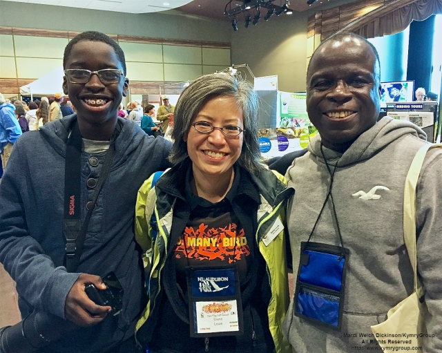 L. to R. Kojo Baidoo, Young Birder; Diane Louie, NJ Audubon Board Member; Kwamena Baidoo. Enjoying Cape May Fall Festival & Trade Show, Convention Hall, Cape May NJ. ©Mardi Welch Dickinson All Rights Reserved.
